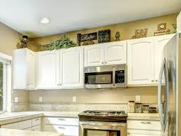 Decorative Items With Distressed Finishes Source Behr Kitchen Design Canisters Above Cabinets