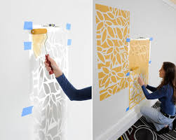 View In Gallery Painting A Wall With The Help Of Stencils