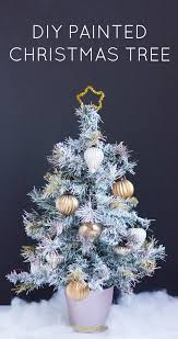 Christmas Tree Flocking Spray Can by Thrifty Diy How To Paint An Artifical Christmas Tree Design