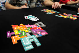 NMBR 9 Jumps On The Current Trend In Board Gaming Of Tetris Like Spatial Puzzles But This Time Were Going Up Players Stack Flat Number Shaped