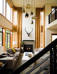 living room with contemporary pendant high ceiling lighting