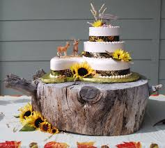 Camo Wedding Cake With Sunflowers And Rustic Wood Slab Stand Toptierweddngcakes