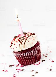 Red velvet cupcake with candle birthday celebration royalty free stock photo