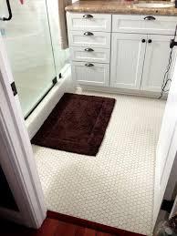 the small white tiles on bathroom floor shower floor