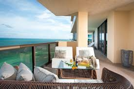 Apartment Balcony Furniture Sofa Chairs Pillows Glass Top Table Railing Flowers Modern Outdoor Area