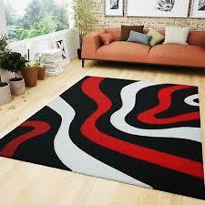 teppich rot schwarz weiß mit wellen muster