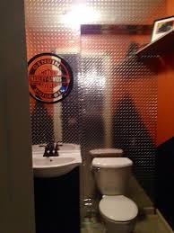 harley davidson themed bathroom done for our basement bar area