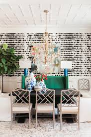 In This Eclectic Dining Room From Kendall Simmons Bold Black And White Wallpaper Becomes A Chic Backdrop For Gold Accents Vibrant Furniture