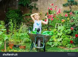 Cute Little Girl Gardening Backyard Childhood Stock Photo ... Gardening In The Pacific Northwest 2013 Backyard Garden Plot With Different Types Of Vegetables Nice Backyards Charming Ideas Vegetable Tips For Planting A Meadow Diy Fairy Gardens 101 By Molly Mackenna Home Design Outdoor Designs Modern Backyard Vegetable Garden Plans Intended Dream Skillzmatic 652 Best My Renovation Images On Pinterest Transform Your Into Botanic Classical Lovely Marvelous Recession Benefits Of Raising Chickens Purina Animal Nutrition