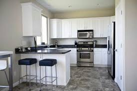 KitchenInterior Entrancing Kitchen Design With White Cabinetry Idea Black Granite Countertops And Chairs Pad Also Rustic Textured Ceramic
