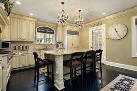 In A Luxuriously Detailed Kitchen High Contrast Informs The Overall Style Dark Hardwood Flooring