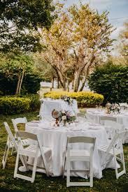 White Garden Wedding Reception Decor With Folding Chairs   Outdoor ...