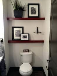 Wall Decor For Bathroom Ideas Guest With Framed Pictures On Small Shelves Above Toilet Full Size