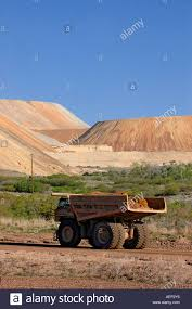 A Huge Dump Truck Drives Down A Dirt Road Dwarfed By The Gigantic ... Big Dump Truck Is Ming Machinery Or Equipment To Trans Tonka Classic Steel Mighty Dump Truck 354 Huge 57177742 Goes In The Evening On Highway Stock Photo Picture Minivan Stiletto Family Holidays Green Photos Images Alamy How Vehicle That Uses Those Tires Robert Kaplinsky Huge Sand Ez Canvas Excavator Loads 118 24g 6ch Remote Control Alloy Rc New Unturned Bbc Future Belaz 75710 Giant Dumptruck From Belarus Video Footage Dumper Winter Frost