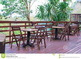 Wooden Table And Chair In Resort And Garden, Dining Set At Wooden ... China White Square Metal Wood Restaurant Table And Chair Set Sp Interior Design Chairs Painted Ding Modern Wooden Fniture 3d Model Sohocg Amazoncom Giantex 3 Pcs Bistro 2 Vintage Stock Photo Edit Now Alinum Outdoor Chair Stool Restaurant Bistro Fniture Cheap 35pc Sets Cafe Dporticus 5piece Industrial Style Shop Costway Kitchen Pub Home Verona 36 Inch
