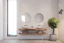schmale fenster badezimmer interieur mit einem betonboden weiße wände ein doppelwaschbecken und zwei runde spiegel ein topfbaum in der ecke spott