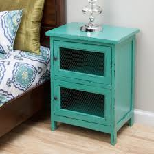 Turquoise Nightstand With Brown Handle On Wooden Floor Matched White Wall Plus Bedding For Home