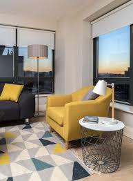 Geometric Pattern Window Curtains by Living Room Yellow Armchair Black Sofa Tall Floor Lamp Glass