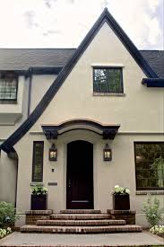 otis construction with tudor home exterior traditional and