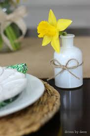 A Single Cut Daffodil In Small Vase Next To Each Spring Table Placesetting