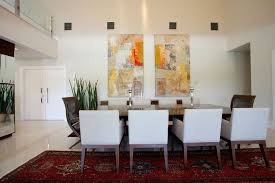 Adjustable Natural Dining Room Wall Decor Ideas Presenting Glossy Wooden Table And White Chairs Plus Double Canvas Art On Red Persian Rug