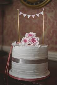 Topped With Blush Pink Roses And Miniature Bunting This Ivory Design Is Pure Prettiness Just The Ticket For A Chic Country Wedding Cherry Blossom Cakes