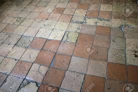 cracked ceramic floor tiles terracotta color stock photo