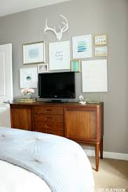 Hide Your Bedroom TV Amongst A Gallery Wall Of Art Find Great Canvases