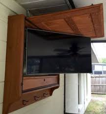Here are our plans for an outdoor TV cabinet we built for our