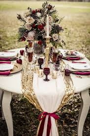 Decorations Fall Wedding Table Setting With A Gold Runner And Burgundy Glasses