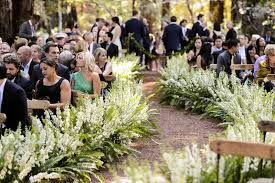 Fern And White Larkspur Flowers On Dirt Aisle At Ceremony