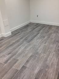 flooring cost estimator labor to install tile per square foot vs
