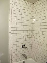 white subway tile shower with marble pencil trim detail in master