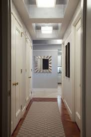 interior hallway ceiling light with square glass shade hanging on