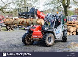 A Manitou Forklift Truck Lifts A Tree Trunk At A Sawmill Stock Photo ... Challenger Offers Heavyduty 4post Truck Lifts In 4600 Lb 4 Post Lifts Forward Lift 2 Pse 15000 Oh Overhead Automotive Car Truck Tail Palfinger A Manitou Forklift A Tree Trunk At Sawmill Stock Photo 2008 Ford F350 With 14inch The Beast Suspension Kits Leveling Tcs Equipment Vehicle Supplier Totalkare 500 Elliott L60r Truckmounted Aerial Platform For Sale Or Yellow Fork Orange Pupmkin Illustration Rotary World S Most Trusted