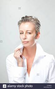 beautiful middle aged woman wearing white with low collar blouse
