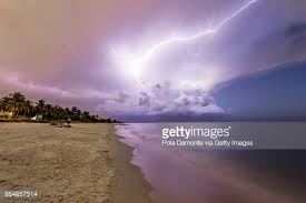 Amazing Lightning Storm Sunset And Calmed Ocean At Naples Beach