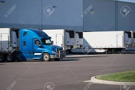 100 Huge Trucks A Number Of Big Rig Semi Are Loaded And Unloaded In The