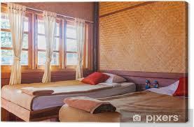 leinwandbild schlafzimmer in hütte resorthotel