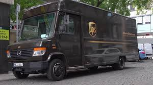 UPS Truck Delivering Package To Local Frankfurt Germany Business 4k ... 18 Secrets Of Ups Drivers Mental Floss The Truck Is Adult Version Of Ice Cream Mirror Front Center Roy Oki Has Driven The Short Route To A Long Career Truck And Driver Unloading It Mhattan New York City Usa Plans Hire 1100 In Kc Area The Kansas Star Brussels July 30 Truck Driver Delivers Packages On July Stock Picture I4142529 At Featurepics Electric Design Helps Awareness Safety Quartz Real Fedex Package Van Skins Mod American Simulator Exclusive Group Formed As Wait Times Escalate Cn Ups Requirements Best Image Kusaboshicom By Tricycle Portland Fortune