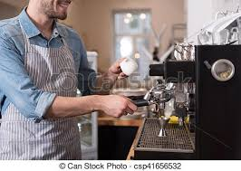 Pleasant Smiling Man Using Coffee Machine