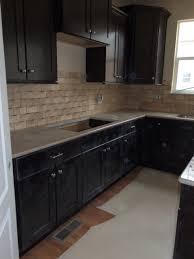Merillat Kitchen Cabinets Online by Merillat Tolani Maple Staggered Cabinets In Kona Denova Quartz