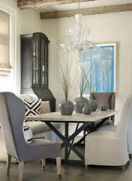 Use Bright Artwork To Give A Burst Of Color Neutral Dining Room Casual