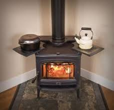 Wood Stove With Cooktop And Large Window Perfect For Placing In Kitchen