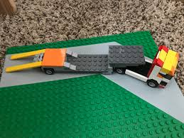 Lego Semi Truck And Trailer Set - RT's House Of Coolness! Lego Toys R Us City Truck Itructions 7848 Old Long Nose Working Semi Pulling The Dhl Trailer Moc3961 Truck Town 2015 Rebrickable Build Lego 05591 Red Bird Trailer And Jet By Knightranger Lego T2 Mkii With Lowboy Tr4 Mkll Dolly Flatbed I Saw This Kind Of Crane Section On A Flat Flickr Custombricksde Custom Modell Moc Thw Fahrzeug Vehicles Bdouble Curtainsider Pictures Review The Brick Fan