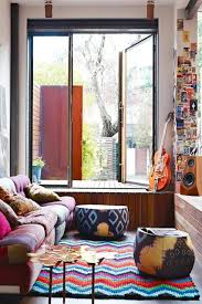 Designer Contemporer Minimalist Apartment Living Room Design Ideas In Bohemian Style With Unique Puff Beside Colorful Sofa And Tribal Patterns Carpet