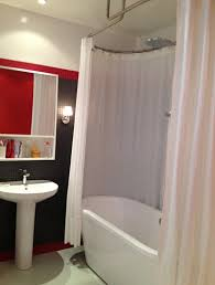dispositif barres rideau de ovale galbotwins et baignoire