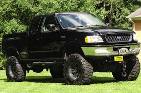 99 Ford Truck Lifted JACKED UP MUD TRUCK FORD F 150 LIFTED MUDDER 37X13 5X17 MUD With