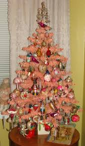 From The 1930s A RARE 4 Ft PINK Feather Tree Decorated With Vintage Antique Ornaments In Bright Colors Background Santa Doll Dressed