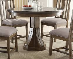 Ortanique Dining Room Table by Willowbrook Craftsman Ash Bluestone Laminate Top Round Dining
